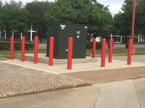 Red Bollards Protecting Utility
